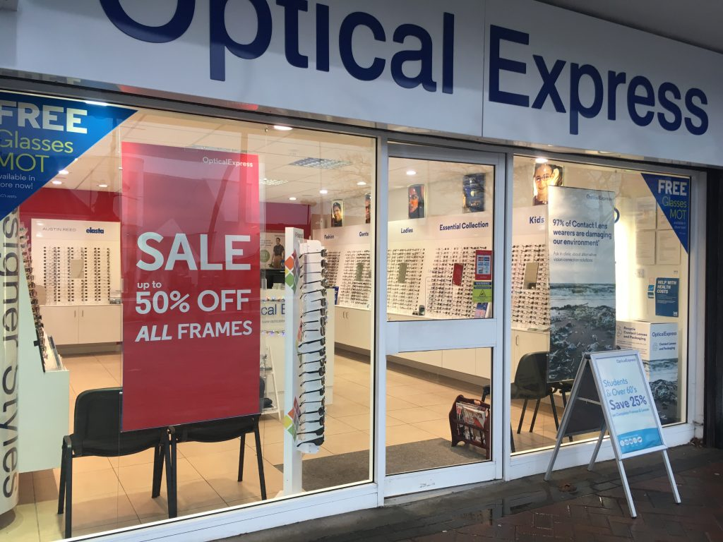 optical express displaying 50% off sale in shop windows