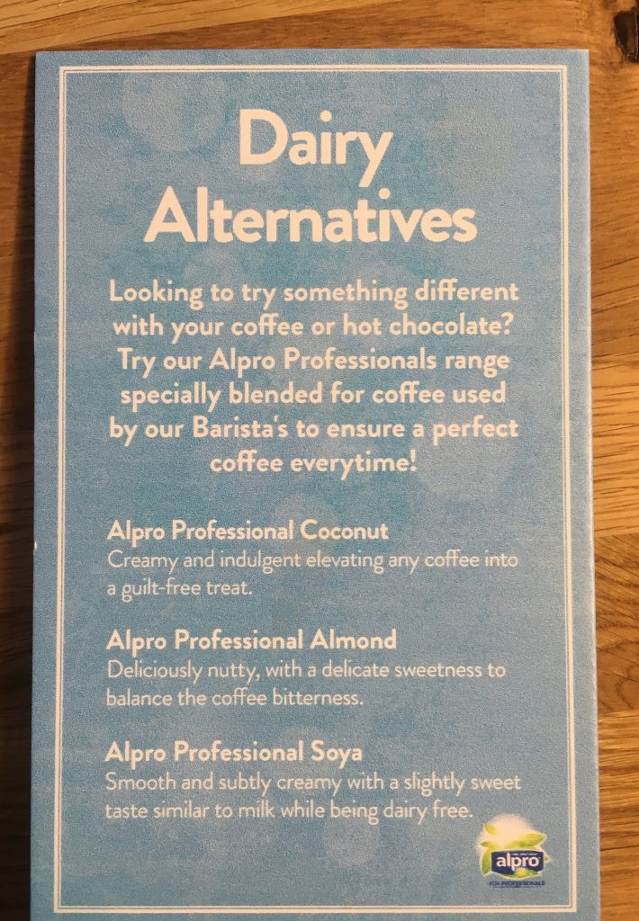 Dairy alternatives at Costa listing alpro coconut, almond and soya as part of Veganuary in Milngavie